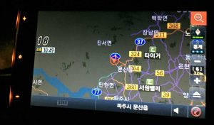 The car GPS showing North and South Korea.